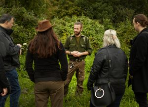 foraging teacher talking at event in the woods